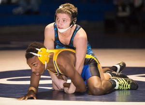 Decatur wrestler Robert Kaminski reached the 100-victory milestone in his prep career last weekend. Pictured above is Kaminski in a win over Wicomico's Devin Webster last week.  Photo by Earl Campbell