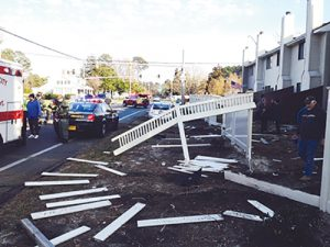 Damage to the fence around the South Point Village neighborhood caused by an alleged drunk driver is pictured Saturday afternoon. Photo by Shawn Soper