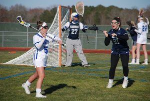 Decatur's Claire Porter sets the offense during the second half of the Seahawks' 10-5 win over Saints Peter and Paul on Wednesday. Porter led the Seahawks with three goals.  Photo by Shawn Soper