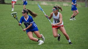Decatur Girls Pull Away From Worcester, 13-7