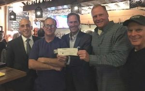 Ocean City Surf Club Receives $1,000 Donation From Longboard Cafe