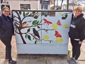 Volunteers From The Art League Of OC Paint Utility Box On Wicomico Street And Baltimore Avenue
