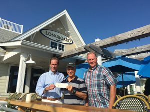 Ocean City Surf Club Receives Donation From Longboard Café