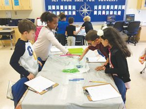 Third-Grade Scientist At OC Elementary Conduct Experiment On Fish